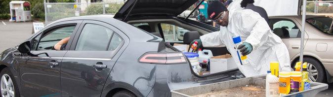 unloading hazardous waste from a car