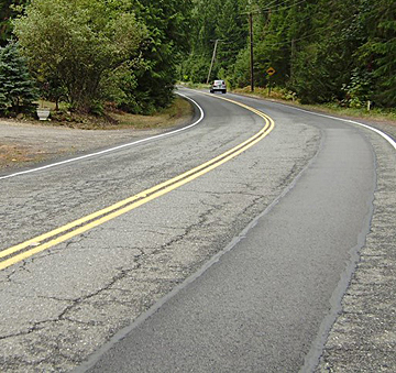 Patched road with cracking visible