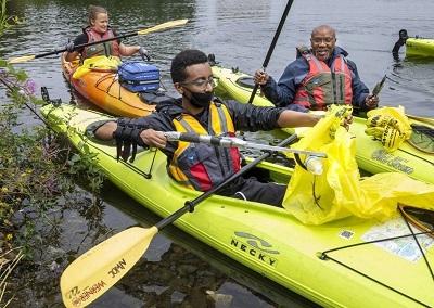 people in kayaks on a lake