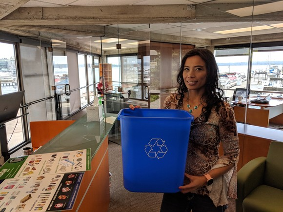 business owner holding free recycling can