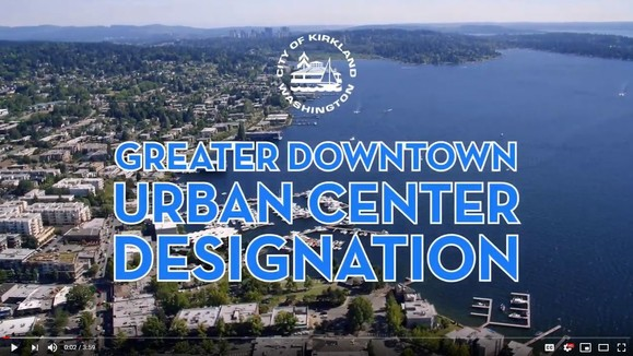 Greater Downtown Kirkland Urban Center over drone footage of Lake Washington and downtown