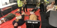 volunteers with pretend injuries laying on the floor at a CERT drill event