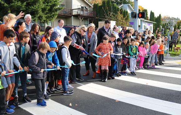 children and mayor at ribbon cutting on 6th street