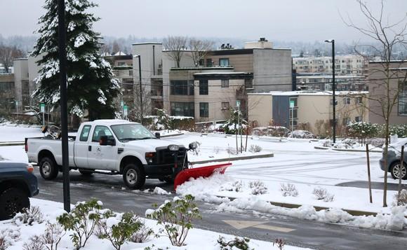 snow plow in parking lot