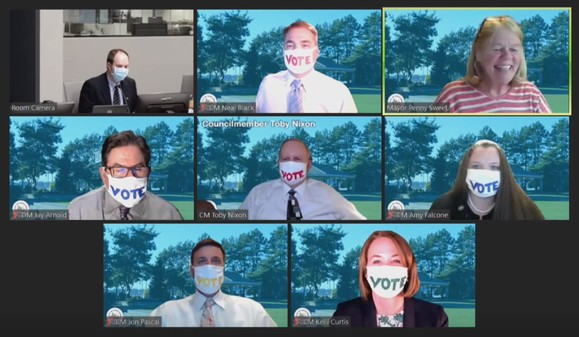 Council wearing VOTE masks