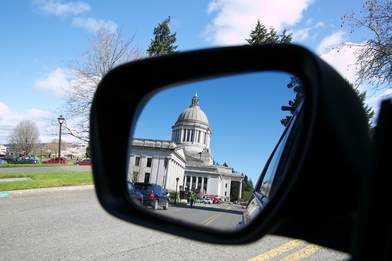 photo of Washington state capitol dome in car side mirror reflection