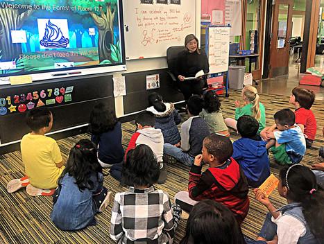 Slatter reading to elementary kids