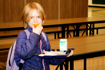 Student Eating Orange