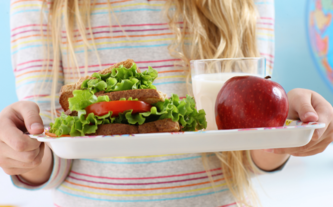 Child Holding School Lunch