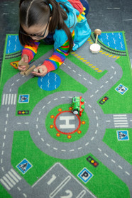 girl playing with trains