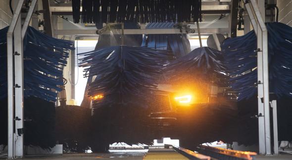 A car going through an automated car wash.