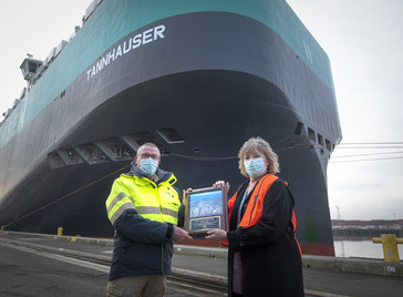Port of Tacoma Commissioner Deanna Keller presented a plaque to Capt. Stefan Sjöstrand of Wallenius Wilhelmsen Ocean's MV Tannhauser.