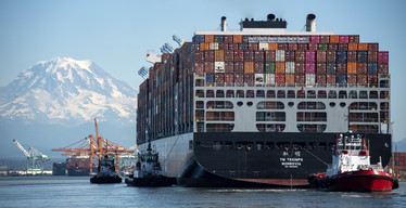 photo of  large container ship arriving at a port