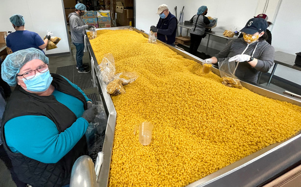 photo of people repacking pasta