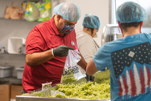 photo of a man repacking vegetables