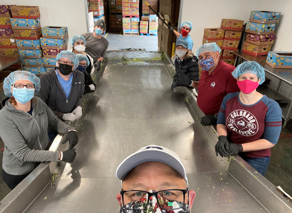 a selfie of a group repacking food