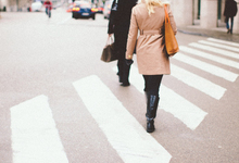 Woman walking along crosswalk