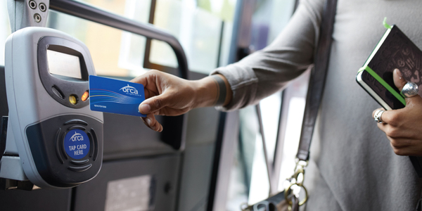 Transit rider using their ORCA card