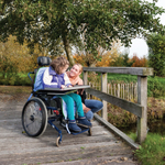 Girl in wheelchair enjoying nature