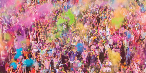 Hundreds of people throwing colors at Holi Festival