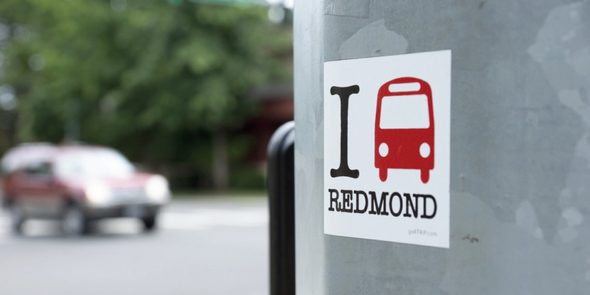 Sticker on light pole that says I bus Redmond
