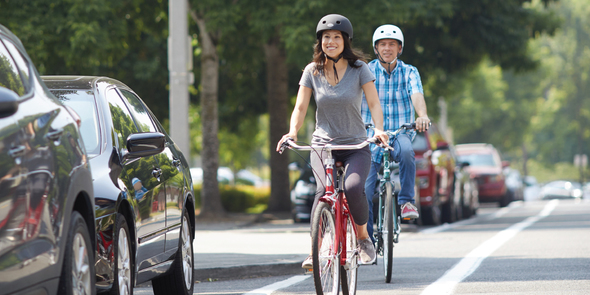 Man and woman bicycling in Downtown Redmond
