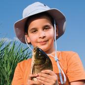 Boy holding up fish