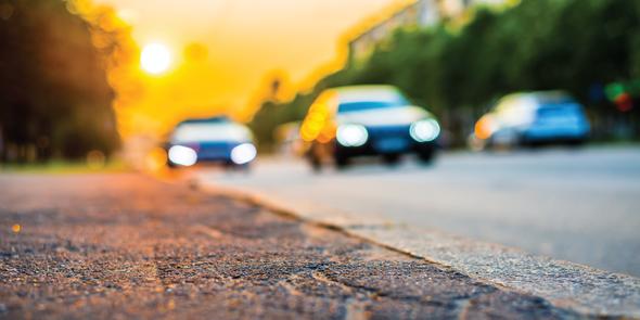 Cars driving down an urban street