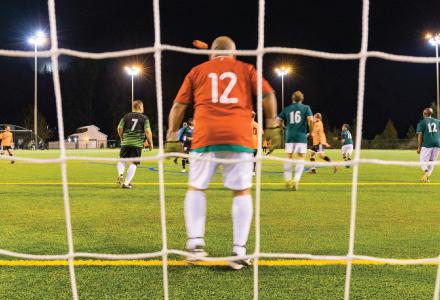 Adult soccer league under the lights at Perrigo Park