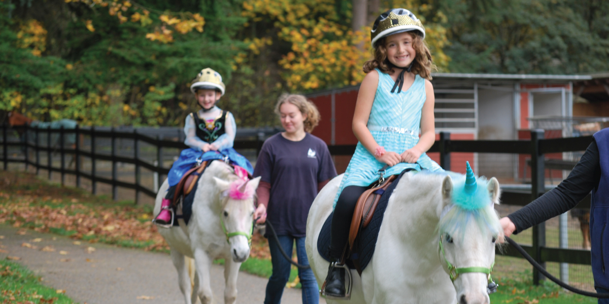 Young girls riding ponies
