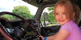 Girl pretending to drive big truck