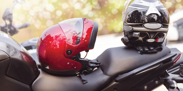 Motorcycle with two helmets sitting on top