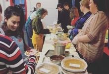Teens at serving pie