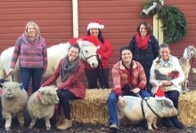 People posing for holiday photo at a farm