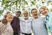 Senior Citizens standing together and smiling
