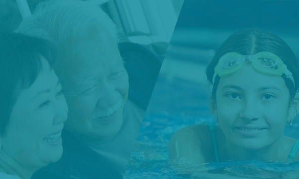 Senior Citizens smiling and young girl swimming in pool