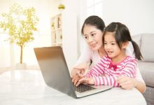 Mother and child using laptop