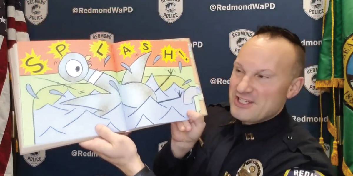Police Officer reading children's book