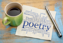 The word poetry is printed on napkin and next to cup of coffee