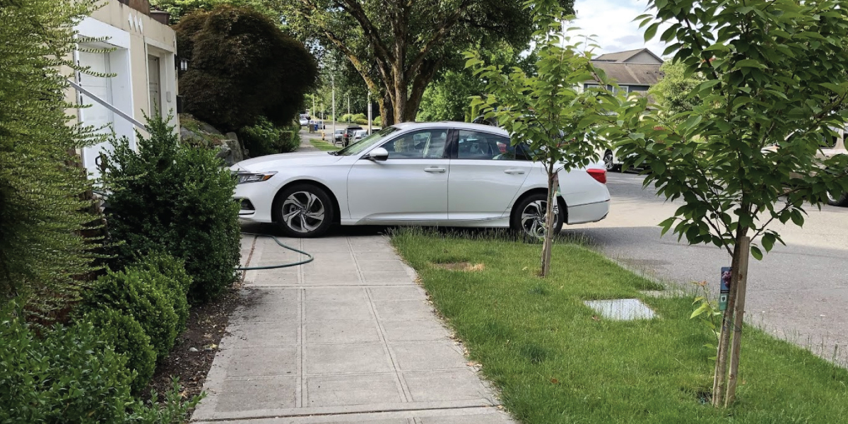 Car parked on sidewalk