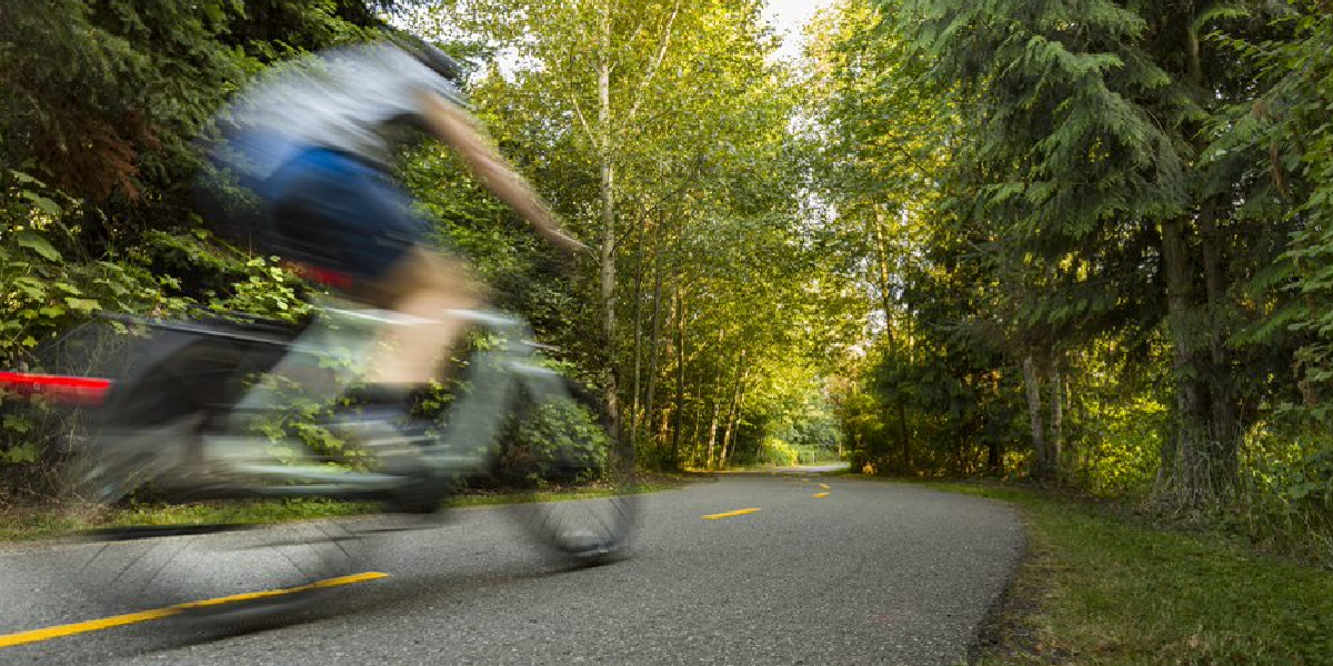 bicyclist riding on trail