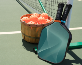 Pickleball paddles and balls laid out on the court next to the net