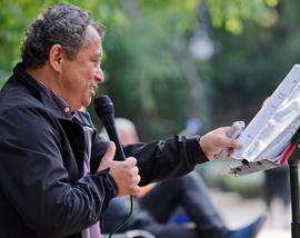 Busker performing spoken word in a park