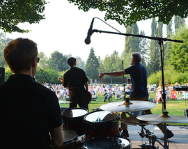 On stage with a band performing at Rockin' on the River looking towards the crowd