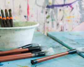 Photo of paint brushes and other painting supplies