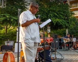 Photo of Redmond Poet Laureate, Raul Sanchez, performing at 2019 So Bazaar