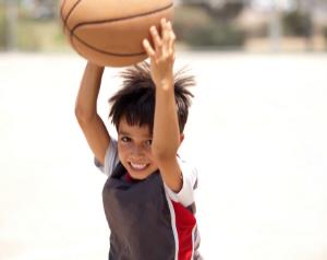 Kid bouncing a basketball