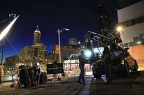 A film crew working at night