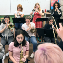 Members of an all-girls jazz ensemble during a rehearsal session