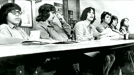 First female Seattle City Light line workers seated at a table
